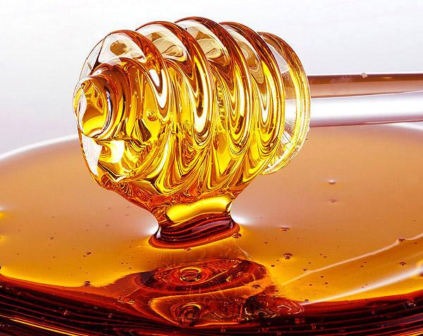 Золотой мед на палочке фото