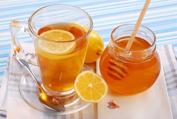 Чай с лимоном и пчелиный продукт фото