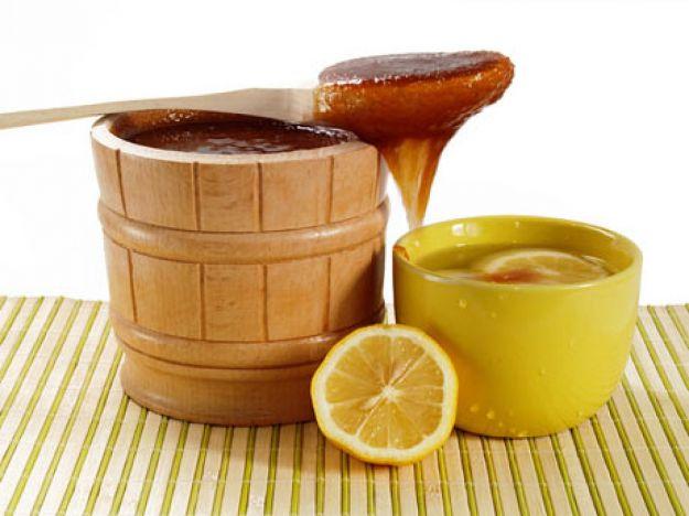 Лимон и мед в кадке фото