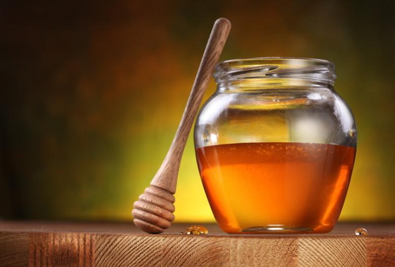Фото золотого пчелиного продукта в банке