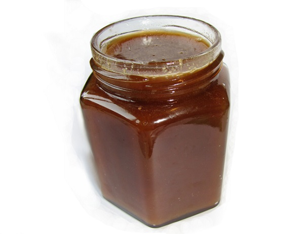 Натуральный гречневый мед в банке фото