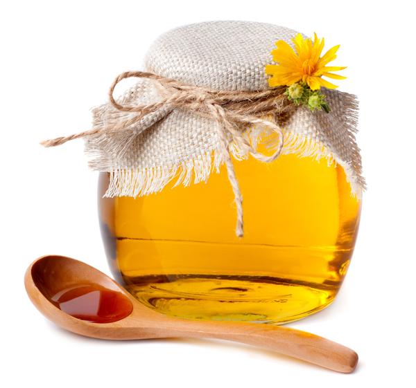 Фото банки с медом и деревянной ложки