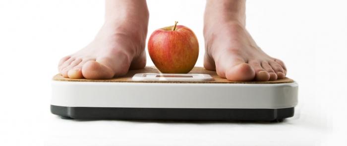 Фото человека на весах