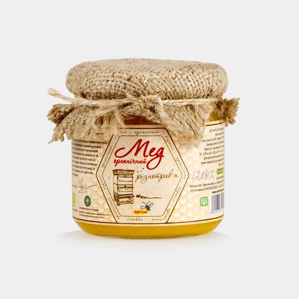 Фото органического меда разнотравье в баночке с мешковиной