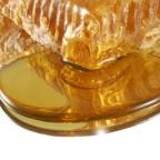 Фото вытекающего из сот меда